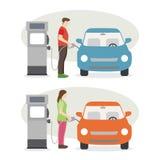 男人和妇女填满燃料在加油站 图库摄影