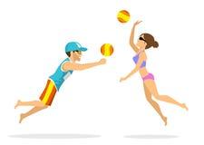 男人和妇女沙滩排球球员 免版税库存图片