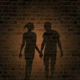 男人和妇女的阴影在墙壁上 库存照片