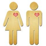 男人和妇女符号回收纸张 免版税库存照片