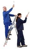 男人和妇女重新装修 库存照片