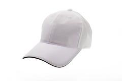 男人或妇女的白色高尔夫球帽 库存照片