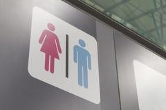 男女卫生间标志,女性桃红色男性蓝色 免版税库存照片