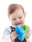 男婴愉快的使用的纵向玩具 免版税图库摄影