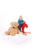 男婴骑马摇摆物 库存图片