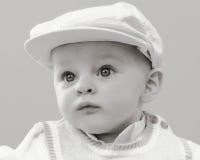 男婴高尔夫球运动员帽子 免版税库存图片