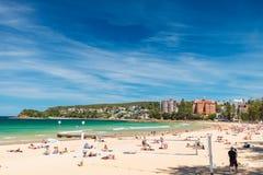 男子气概的海滩的人们 免版税库存照片