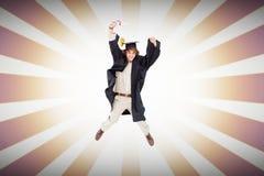 男学生的综合图象毕业生长袍跳跃的 图库摄影