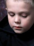 男孩一点疲倦了 免版税库存照片