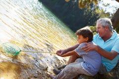 男孩一起捕鱼人 免版税库存图片