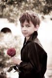 男孩与在他的现有量起来了 免版税图库摄影
