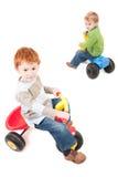 男孩乘坐三轮车的儿童孩子 免版税库存照片