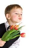 男孩亲吻一点发送 免版税图库摄影