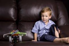 男孩他的玩具 图库摄影