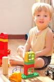 男孩他的玩具 免版税图库摄影