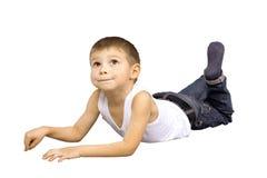 男孩位于胃 免版税库存图片