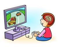 男孩使上瘾对打电子游戏 库存照片