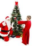 男孩使圣诞老人惊奇 免版税库存图片