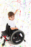 男孩儿童残疾绘画轮椅 免版税图库摄影