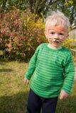 男孩儿童表面油漆老虎 免版税库存照片