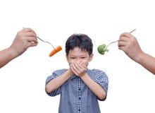 男孩关闭他的嘴用人工 免版税库存照片