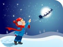 男孩再见小圣诞老人说 免版税库存照片