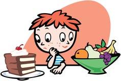 男孩决定吃对什么 免版税库存照片