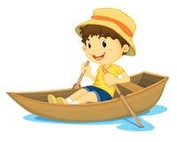 男孩划船 库存照片