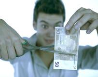 男孩剪切货币 免版税图库摄影