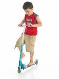 男孩印地安人滑行车 免版税库存照片