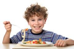 男孩吃 免版税库存图片
