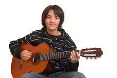 男孩吉他使用 免版税库存图片