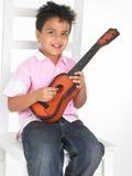 男孩吉他 库存图片