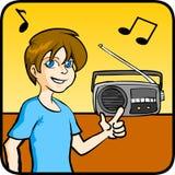男孩听的音乐 图库摄影