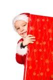 男孩和圣诞节礼物 库存图片