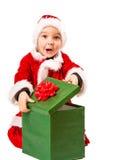 男孩和圣诞节礼物 免版税库存图片