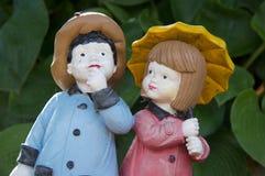 男孩和女孩小雕象 免版税库存图片