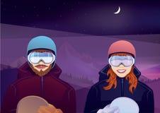 男孩和女孩有户外雪板的 库存照片
