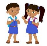 男孩和女孩有背包学生的停留动画片学校 免版税库存照片