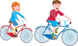 男孩和女孩自行车的 库存图片