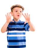 男孩和布料盖帽 库存照片