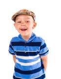 男孩和布料盖帽 免版税库存图片