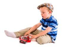 男孩和玩具汽车 免版税图库摄影