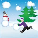 男孩和雪人 免版税库存图片
