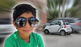 男孩和他的第一辆微型汽车 库存图片