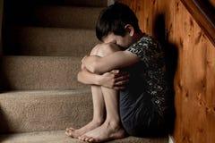男孩哀伤的年轻人 库存照片
