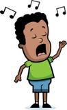 男孩唱歌 免版税库存照片