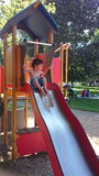 男孩喜欢使用在公园 免版税库存照片