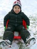 男孩喜欢使用在雪 免版税图库摄影