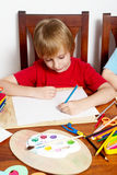 男孩图画回归学校 免版税库存照片